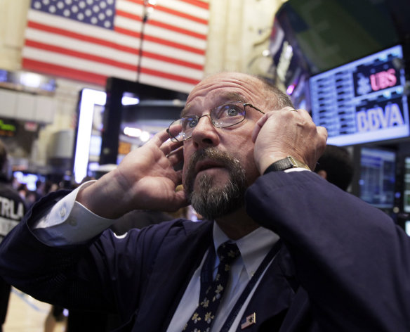 In this Sept. 20, 2012, file photo Trader Frederick Reimer works on the floor of the New York Stock Exchange. World stock markets fell Monday, Sept. 24, 2012 weighed down by a host of concerns about the global economy. (AP Photo/Richard Drew, File)