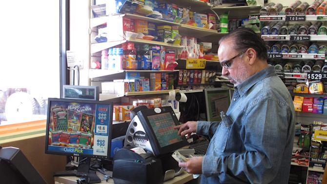 Gary Narang, the owner of a 7-11 franchise, punches out an order for Powerball tickets in his convenience store on Monday, Nov. 26, 2012, in Long Beach, N.Y. FEMA, insurance adjusters and construction cleanups. Some of the people hardest hit by Superstorm Sandy are hoping one thing this week answers their prayers: a $425 million Powerball jackpot. Long Beach, outside New York City, was one of the hardest hit by last month's Superstorm Sandy. (AP Photo/Frank Eltman)