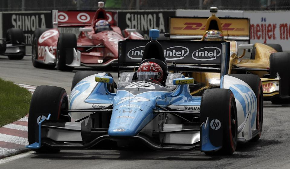 Simon Pagenaud, of France, races during the IndyCar Detroit Grand Prix auto race on Belle Isle in Detroit, Sunday, June 2, 2013. (AP Photo/Paul Sancya)