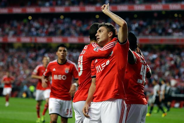 Benfica's Siqueira, second right, celebrates after scoring the opening goal during their Portuguese league soccer match against Nacional at Benfica's Luz stadium in Lisbon, Sunday, Oct. 27 2013