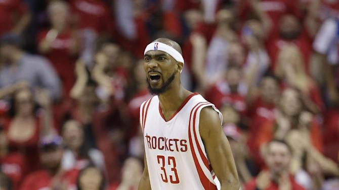 Houston Rockets' Corey Brewer (33) celebrates after scoring against the Dallas Mavericks during the second half of game 1 in the first round of the NBA basketball playoffs Saturday, April 18, 2015, in Houston. (AP Photo/David J. Phillip)