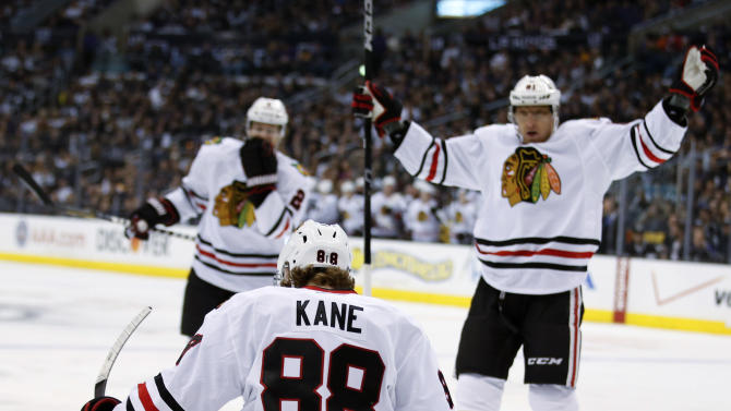 Chicago Blackhawks' Patrick Kane, foreground, celebrates his goal during the first period of an NHL hockey game against the Los Angeles Kings in Los Angeles, Saturday, Jan. 19, 2013. (AP Photo/Jae C. Hong)