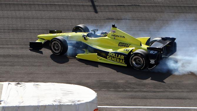 IndyCar driver Josef Newgarden spins past the entrance to the pit area on the front straight after losing control of the car exiting the fourth turn during practice for the Indianapolis 500 auto race at the Indianapolis Motor Speedway in Indianapolis, Wednesday, May 16, 2012. (AP Photo/Don Larson)