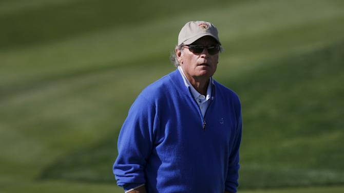 Tim Neher walks across the eighth green during the final round of the Pebble Beach Pro-Am golf tournament