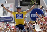 US cyclist Lance Armstrong celebrates as he crosses the finish line and wins the Tour de France on July 22, 2004. The disgraced cyclist will talk about the doping scandal that brought down his cycling career during an interview with Oprah Winfrey next week