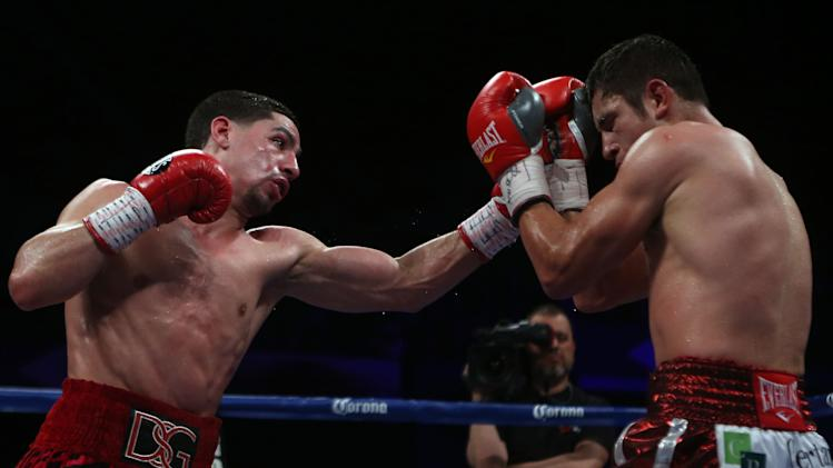 "Unified Super Lightweight World Champion Danny ""Swift"" Garcia, left, punches Mauricio ""El Maestro"" Herrera during the fourth round of a Super Lightweight boxing match at the Ruben Rodriguez Coliseum in Bayamon, Puerto Rico, Saturday, March 15, 2014. Garcia won by majority decision over Herrera. (AP Photo/Ricardo Arduengo)"