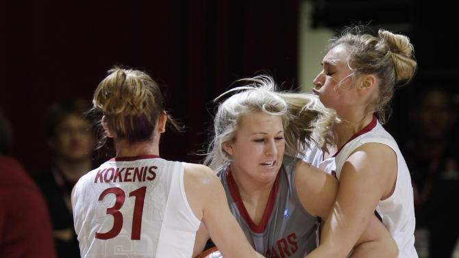 Washington State guard Jordan Kelley, center, is closely guarded by Stanford guard Toni Kokenis (31) and forward Joslyn Tinkle, right, in the first half of an NCAA college basketball game in Stanford, Calif., Thursday, Jan. 19, 2012. (AP Photo/Paul Sakuma)