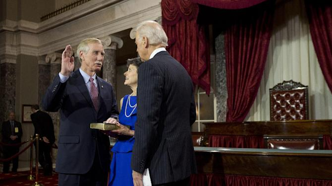 Vice President Joe Biden administers the Senate Oath to Sen. Angus King, I-Maine, accompanied by his wife Mary Herman, during a mock swearing in ceremony on Capitol Hill in Washington, Thursday, Jan. 3, 2013, as the 113th Congress officially began.  (AP Photo/ Evan Vucci)