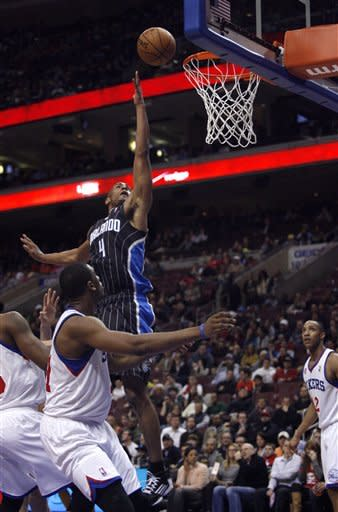 Magic end road skid at 10, rout 76ers