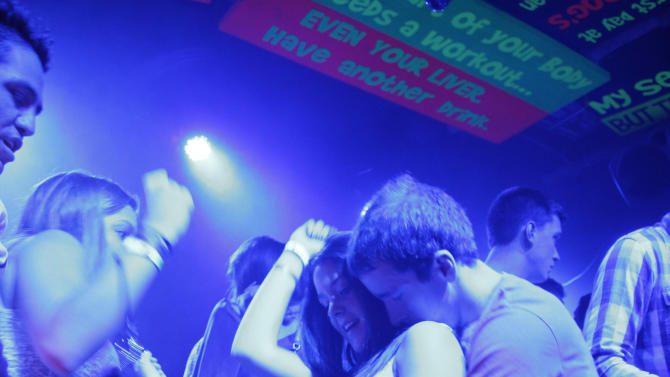 In this March 7, 2012 photo, people dance at a bar during Spring Break in Cancun, Mexico.  While American tourism to Mexico slipped a few percentage points last year, the country remains by far the biggest tourist destination for Americans, according to annual survey of bookings by the largest travel agencies. (AP Photo/Israel Leal)