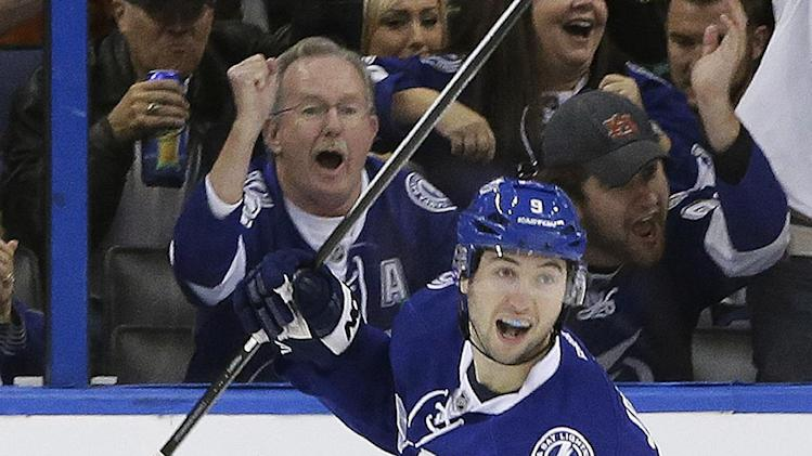Tampa Bay Lightning center Tyler Johnson (9) celebrates his shorthanded goal against the Phoenix Coyotes during the first period of an NHL hockey game Monday, March 10, 2014, in Tampa, Fla. (AP Photo/Chris O'Meara)