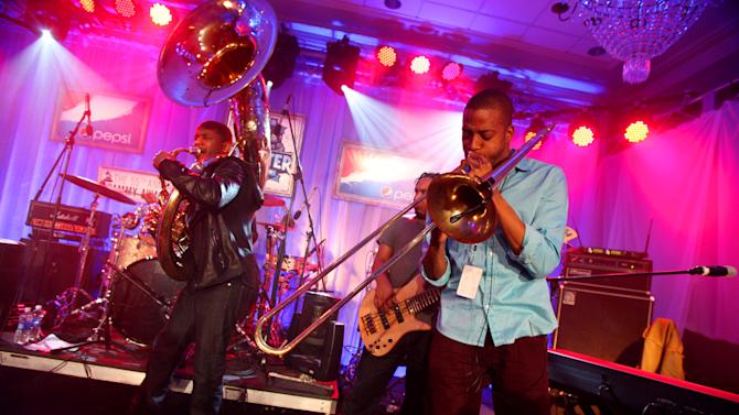 IMAGE DISTRIBUTED FOR PEPSI - Trombone Shorty performs with The Roots at the Pepsi 5th Quarter in the French Quarter Post Super Bowl Party, on Sunday, Feb. 3, 2013, in New Orleans. (Photo by Barry Brecheisen/Invision for Pepsi/AP Images)