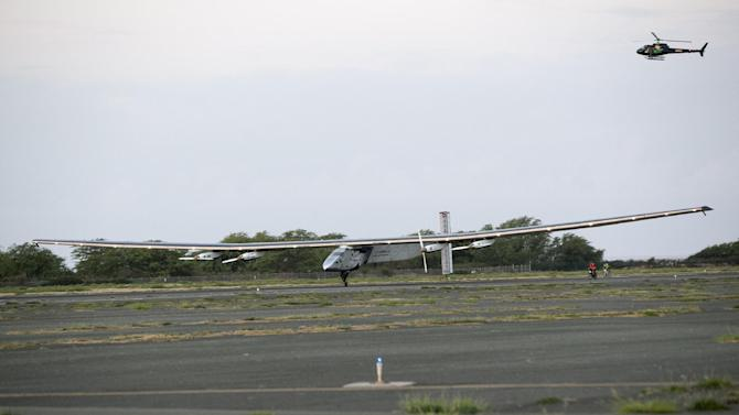 The Solar Impulse 2, a solar-powered airplane, lands at the Kalaeloa Airport, Friday, July 3, 2015 in Kapolei, HI.  The plane, piloted by Andre Borschberg, is attempting to fly around the world without fuel.  (AP Photo/Marco Garcia)