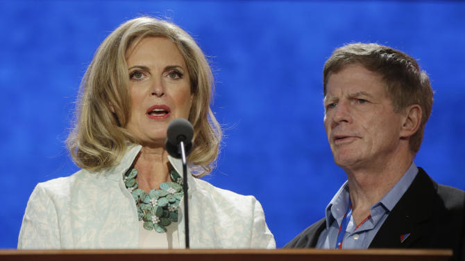 Ann Romney, wife of U.S. Republican presidential candidate Mitt Romney, looks over the main stage during a sound check, as Stuart Stevens, senior advisor for Romney campaign, right, watches at the Republican National Convention in Tampa, Fla., on Tuesday, Aug. 28, 2012. (AP Photo/Charles Dharapak)