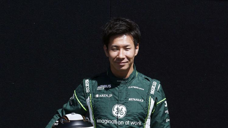 Caterham Formula One driver Kamui Kobayashi of Japan poses during a photo session before the Australia Formula One Grand Prix at Melbourne's Albert Park Track