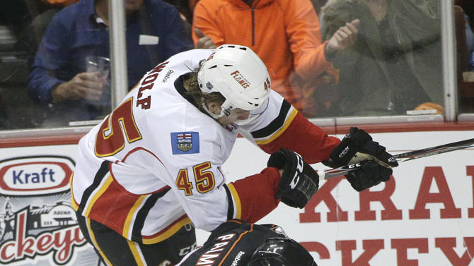 Calgary Flames' David Wolf, top, and Anaheim Ducks' Kyle Palmieri fight for the puck during the first period of Game 2 in the second round of the NHL Stanley Cup hockey playoffs, Sunday, May 3, 2015, in Anaheim, Calif. (AP Photo/Jae C. Hong)