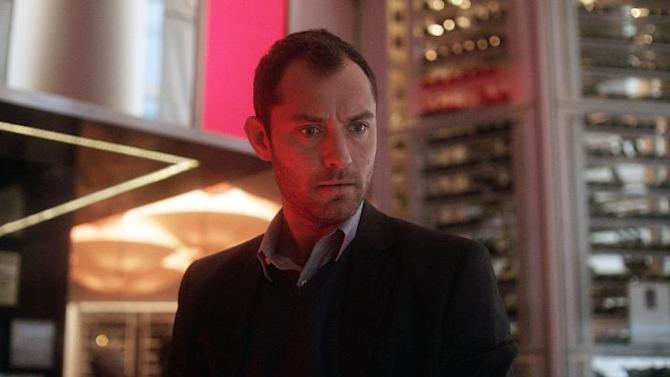 "This film image released by Open Road Films shows Jude Law in a scene from ""Side Effects."" (AP Photo/Open Road Films)"