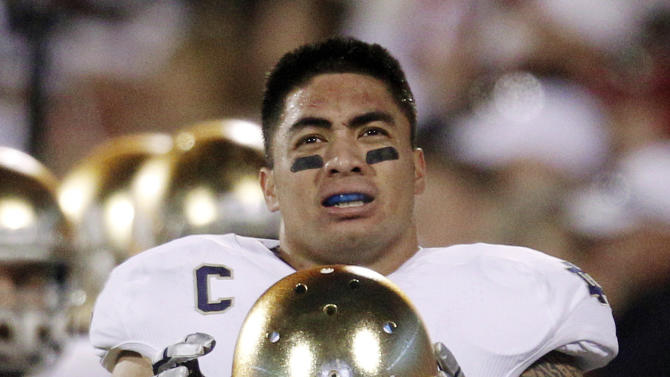 FILE - In this Oct. 27, 2012, file photo, Notre Dame linebacker Manti Te'o stands on the sidelines during an NCAA college football game against Oklahoma in Norman, Okla. Notre Dame issued a release Wednesday, Jan. 16, 2013, saying a story about Te'o's girlfriend dying, which he said inspired him to play better as he helped the Fighting Irish get to the BCS title game, turned out to be a hoax apparently perpetrated against the linebacker. (AP Photo/Sue Ogrocki, File)