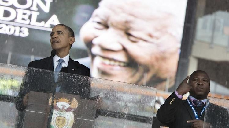 A sign language interpreter is seen while US President Barack Obama speaks during the memorial service at FNB Stadium December 10, 2013 in Johannesburg, South Africa