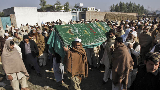 Pakistani relatives and mourners carry the body of aid worker Lubna Mahmoud, 26, who was killed on Tuesday, by gunmen, during her funeral procession in Swabi, Pakistan, Wednesday, Jan. 2, 2013. Gunmen on motorcycles sprayed a van carrying employees from a community center with bullets Tuesday, killing five female teachers and two aid workers, but sparing a child they took out of the vehicle before opening fire. (AP Photo/Mohammad Sajjad)