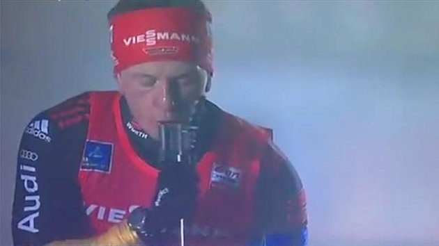 Florian Graf points a loaded rifle at his face (Eurosport)