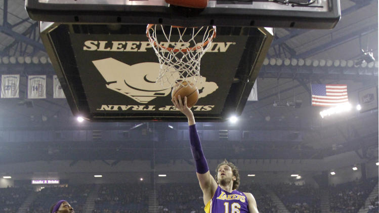 Los Angeles Lakers forward Pau Gasol, of Spain, goes to the basket between Sacramento Kings' DeMarcus Cousins, center, and Aaron Brooks, right, and as Lakers' Dwight Howard, left, watches during the first quarter of an NBA basketball game in Sacramento, Calif., Wednesday, Nov. 21, 2012.(AP Photo/Rich Pedroncelli)