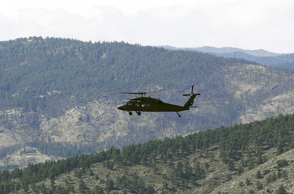 A Blackhawk helicopter with Vice President Biden aboard inspects flood damage near Estes Park, Colo., Monday, Sept. 23, 2013. Biden toured areas of the state hit by flooding. (AP Photo/Ed Andrieski)