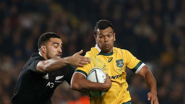 New Zealand All Blacks' Messam looks to tackle Beale of Australia Wallabies during their second Bledisloe Cup rugby championship match in Auckland