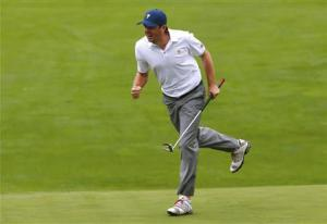 Bradley of the U.S. celebrates after sinking his putt on the 18th hole while playing Day and DeLaet during the continuation of the rain delayed Foursome matches for the 2013 Presidents Cup golf tournament at Muirfield Village Golf Club in Dublin