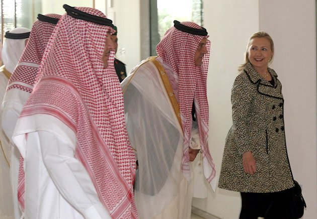 In this photo released by Saudi Press Agency, shows Secretary of State Hillary Rodham Clinton, right, speaks with Saudi Foreign Minister Prince Saud Al Faisal, center, after her meeting with King Abdullah of Saudi Arabia in Riyadh, Saudi Arabia, Friday, March 30, 2012. Clinton sought to work out a unified strategy on the crisis in Syria in talks with Saudi officials on Friday as further violence stymied U.N. efforts to convince Damascus to implement a cease-fire. (AP Photo) NO SALES