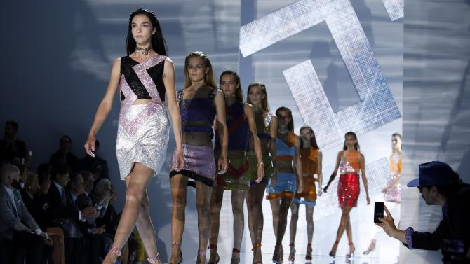 Models parade at the end of the Versace Spring/Summer 2015 collection show during Milan Fashion Week
