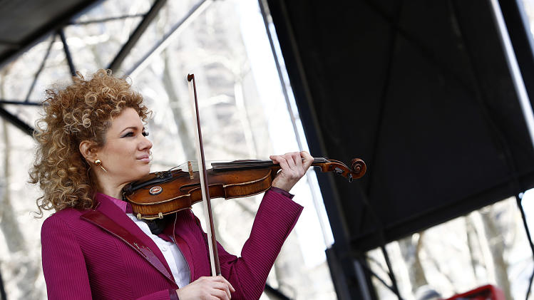 "IMAGE DISTRIBUTED FOR AIDS HEALTHCARE FOUNDATION - Grammy Award-winning violinist Miri Ben-Ari performs at the AIDS Healthcare Foundation's ""Keep The Promise On AIDS"" March and Rally on Saturday, April 6, 2013, in New York. The ""Keep the Promise"" campaign brings together advocates along with entertainers and spiritual and political leaders to remind elected officials that the fight against HIV/AIDS is not yet won. (Brian Ach /AP Images for AIDS Healthcare Foundation)"
