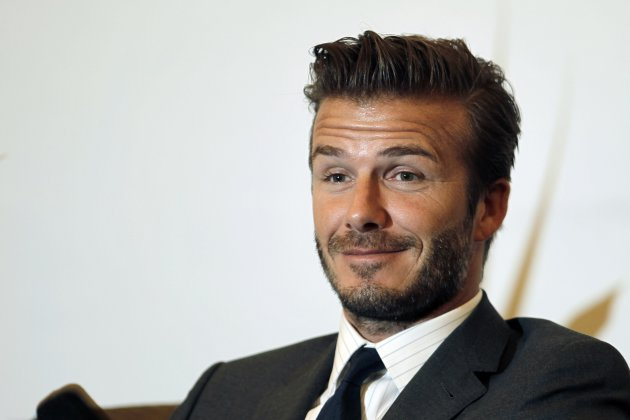 Former England soccer captain David Beckham smiles during a news conference in Shanghai