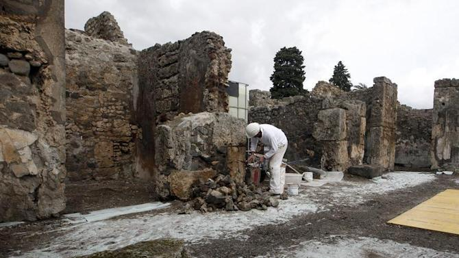 A restorer works in the ancient Roman city Pompeii