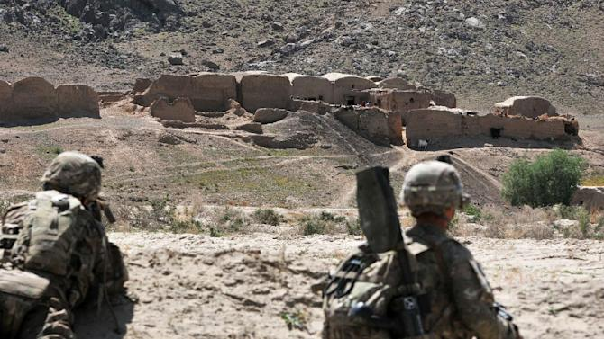 In this April 10, 2013 photo released by the U.S. Army, U.S. Soldiers with Charlie Company, 1st Battalion, 38th Infantry Regiment, 4th Brigade Combat Team, 2nd Infantry Division provide provide security while their comrades serch a village in the Panjwai district of Kandahar province, Afghanistan on a two-day mission to clear the area of explosives caches. The Taliban have announced they will launch their spring offensive on Sunday, April 28, 2013, signaling plans to step up attacks as the weather warms across Afghanistan, making both travel and fighting easier.  (AP Photo/Sgt. Kimberly Hackbarth, U.S. Army)