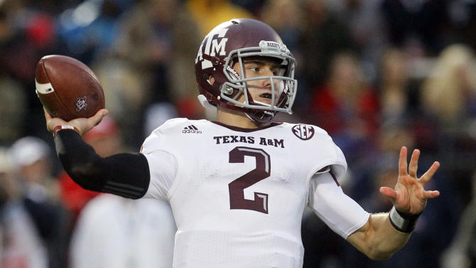 FILE - In this Oct. 6, 2012 file photo, Texas A&M quarterback Johnny Manziel throws a short pass in the first quarter of an NCAA college football game against Mississippi in Oxford, Miss. Manziel could become the first freshman to win the Heisman Trophy when the award is presented on Saturday, Dec. 8, 2012, in New York. (AP Photo/Rogelio V. Solis, File)