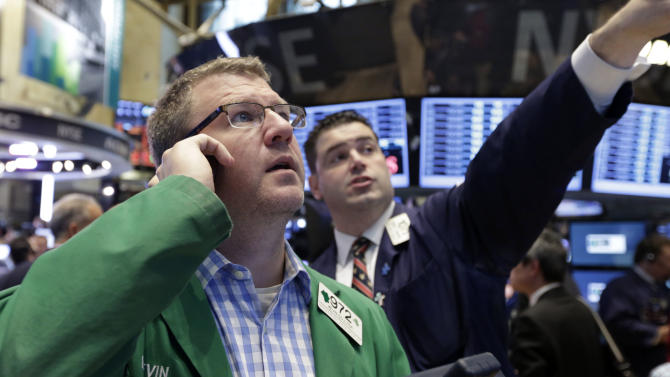 In this Friday, June 28, 2013 photo, trader Kevin Colter, left, works on the floor of the New York Stock Exchange. U.S. stock futures are rising ahead of new data on manufacturing and construction, Monday, July 1, 2013. (AP Photo/Richard Drew)