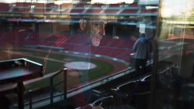 "Actor LeBow, reflected in a window, looks out at the ball park before the Commonwealth Shakespeare Company's production ""Shakespeare at Fenway"" at Fenway Park in Boston"