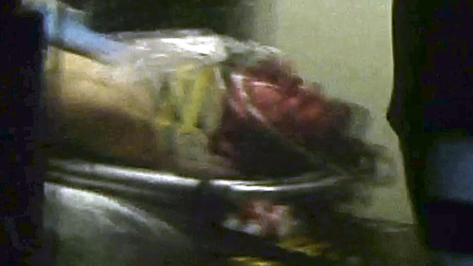 ALTERNATE CROP - This still frame from video shows Boston Marathon bombing suspect Dzhokhar Tsarnaev visible through an ambulance after he was captured in Watertown, Mass., Friday, April 19, 2013. The 19-year-old college student wanted in the Boston Marathon bombings was taken into custody Friday evening after a manhunt that left the city virtually paralyzed and his older brother and accomplice dead. (AP Photo/Robert Ray)