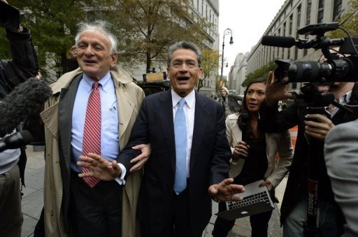 <p>Former Goldman Sachs board member Rajat Gupta (C) leaves federal court in New York after his sentencing. Gupta, the biggest target of a US government blitz on insider trading, was given two years in prison Wednesday, far less than what prosecutors had demanded.</p>