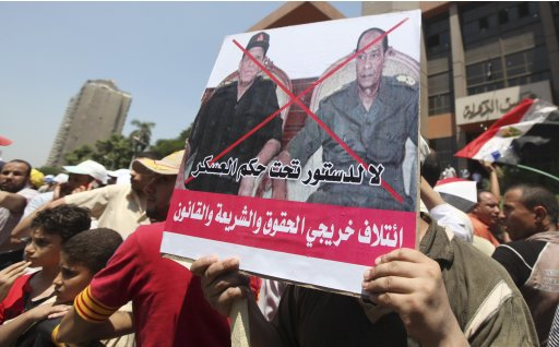 Supporters of Egypt's first Islamist President Mursi shouts slogans in Cairo