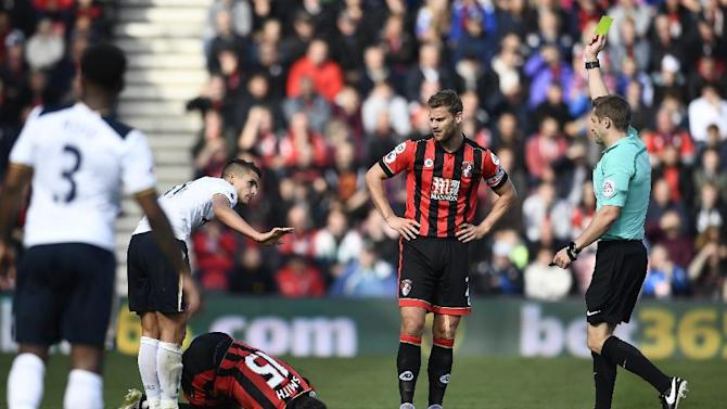 Tottenham's Erik Lamela is shown a yellow card by referee Craig Pawson after a challange on Bournemouth's Adam Smith