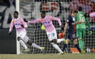 Modou Sougou (L) and teammate Clarck N'Sikulu (2nd L) of Evian Thonon Gaillard celebrate after scoring against Paris St-Germain during their French Ligue 1 soccer match in Annecy December 4, 2013. REUTERS/Robert Pratta (FRANCE - Tags: SPORT SOCCER TPX IMAGES OF THE DAY)