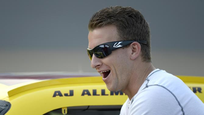 In this Friday, July 6, 2012, photo, AJ Allmendinger helps push his car down pit row during qualifying for the NASCAR Sprint Cup Series auto race at Daytona International Speedway in Daytona Beach, Fla. NASCAR has temporarily suspended Allmendinger after he failed a drug test. Allmendinger won't be allowed to drive Saturday night, July 7, in the Sprint Cup race at Daytona. Instead, Sam Hornish Jr. will be behind the wheel of the No. 22 Dodge for Penske Racing. Allmendinger has 72 hours to request that his B sample be tested. (AP Photo/Phelan M. Ebenhack)