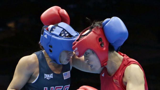 China's Ren Cancan, right, fights Marlen Esparza, of the United States during their women's semifinal flyweight 51-kg boxing match at the 2012 Summer Olympics, Wednesday, Aug. 8, 2012, in London. (AP Photo/Ivan Sekretarev)