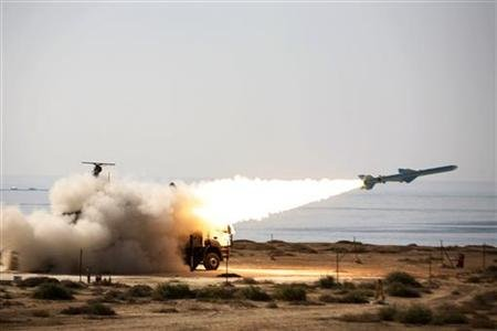 An Iranian long-range shore-to-sea missile called Qader (Capable) is launched during Velayat-90 war game on Sea of Oman's shore