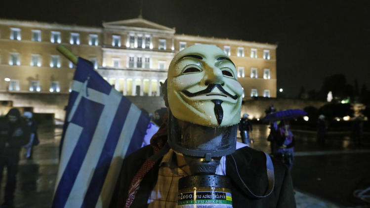 A protester is seen outside the parliament in Athens, Wednesday Nov. 7, 2012. Greece's fragile coalition government faces its toughest test so far when lawmakers vote later Wednesday on new painful austerity measures demanded to keep the country afloat, on the second day of a nationwide general strike. The euro13.5 billion ($17.3 billion) package is expected to scrape through Parliament, following a hasty one-day debate. (AP Photo / Lefteris Pitarakis)
