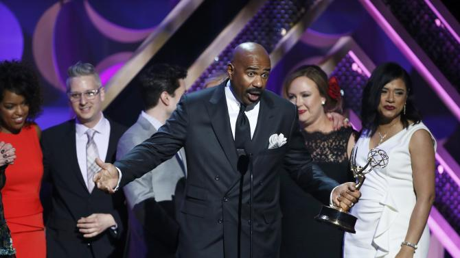 "Television personality Steve Harvey accepts the award for Outstanding Talk Show - Informative for ""The Steve Harvey Show"" at the 42nd Annual Daytime Emmy Awards in Burbank"