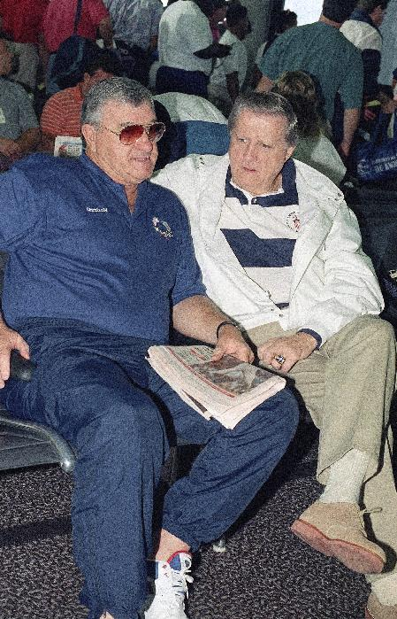 FILE - In this July 22, 1992, file photo, Ron Fraser, left, Olympic baseball coach and former coach of the University of Miami baseball team, talks with New York Yankees owner George Steinbrenner at Tampa International Airport in Tampa, Fla. Fraser, the longtime Miami baseball coach who won two national championships with the Hurricanes and whose innovative marketing ideas helped spark a surge in the college game's popularity, has died. Family spokesman Tony Segreto said Fraser died Sunday morning, Jan. 20, 2013. (AP Photo/Peter Cosgrove, File)