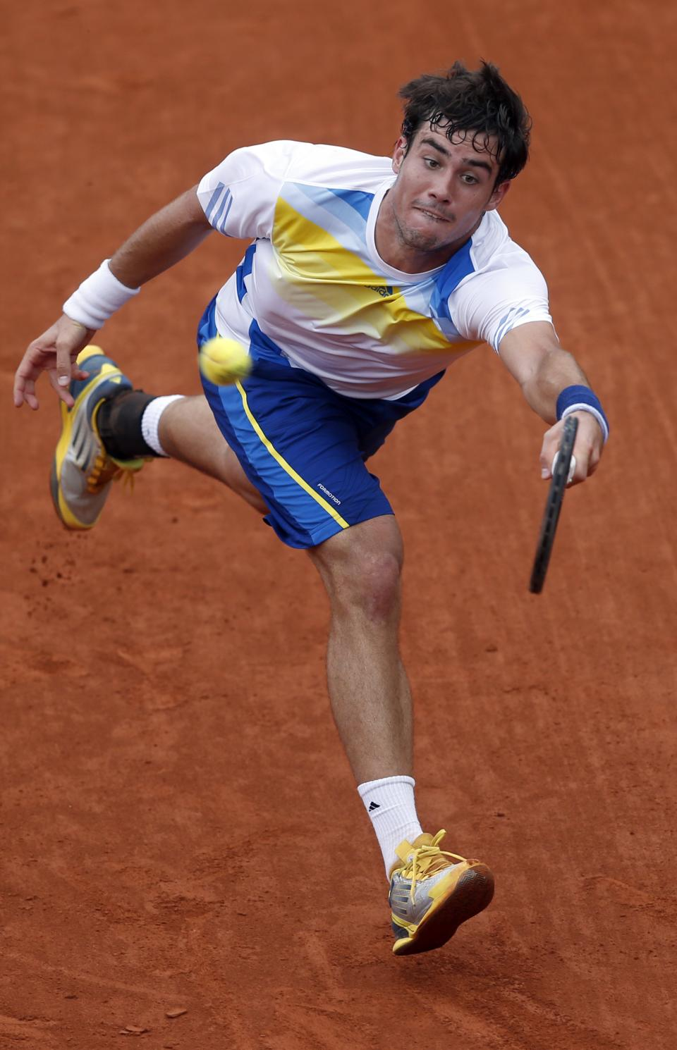 Argentina's Guido Pella returns the ball to Serbia's Novak Djokovic during their second round match of the French Open tennis tournament at the Roland Garros stadium Thursday, May 30, 2013 in Paris. Djokovic won 6-2, 6-0, 6-2. (AP Photo/Petr David Josek)